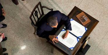 President Barak Obama signs a law