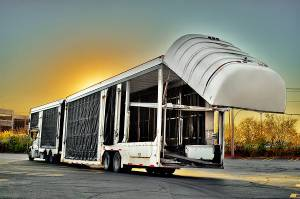 Enclosed car trailer shipping luxury vehicles across USA